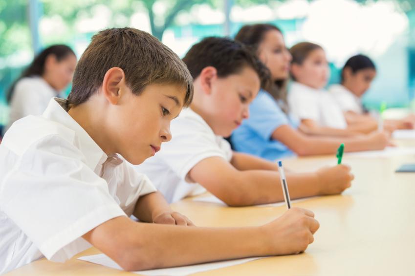 Children taking a test.